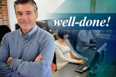 Well-done! against teacher smiling at top of computer class Royalty Free Stock Photos