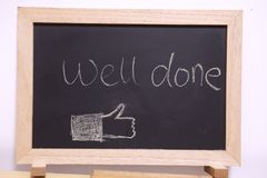 Well done blackboard. Well doneblackboard sign. well done written with chalk on black chalkboard with frame Royalty Free Stock Photos
