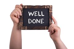 Well done sign. A woman holding chalkboard with words well done isolated on white background stock image