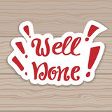 Well done. Vector hand lettering. Hand lettering inscription on the background of wooden boards. Stock Image