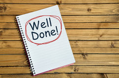 Well done word on notebook Royalty Free Stock Images
