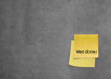 Well done words  on crumpled sticky note paper on texture wall Royalty Free Stock Photo