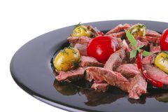 Well down meat slices on dish Royalty Free Stock Photos