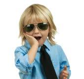 Well-dressed, überraschter netter Junge auf Weiß Stockbild
