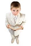 Well-dressed boy hold book Stock Images