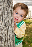 Well Dressed Boy Messy Face Behind Tree Stock Photo