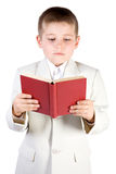Well-dressed boy read book Royalty Free Stock Images