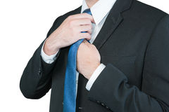 Well dressed business man adjusting his neck tie royalty free stock photos