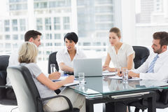 Well dressed business people in discussion at office stock photo