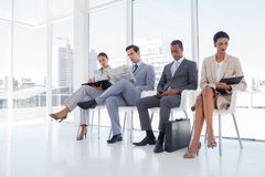 Well dressed business people sat together Stock Photography