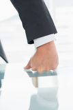 Well dressed businessman with clenched fist on office desk Royalty Free Stock Images