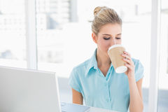 Well dressed businesswoman drinking coffee Royalty Free Stock Photo