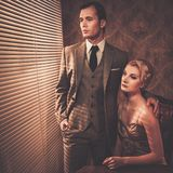 Well-dressed couple in cabinet Royalty Free Stock Photography