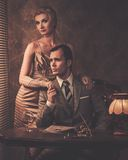 Well-dressed couple in cabinet Royalty Free Stock Images