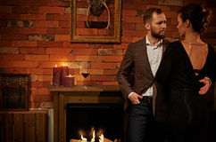 Well-dressed couple in cozy home interior Royalty Free Stock Images