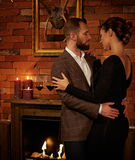 Well-dressed couple in cozy home interior Stock Photo