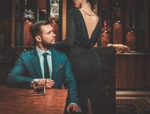 Well-dressed couple in luxury apartment  interior. Royalty Free Stock Images