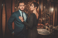Well-dressed couple in Luxury bathroom interior. Royalty Free Stock Image