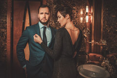 Well-dressed couple in Luxury bathroom interior. Royalty Free Stock Photo