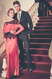 Well-dressed couple in luxury interior Stock Photography