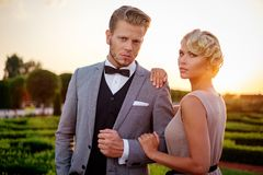 Well-dressed couple in a park Stock Photos