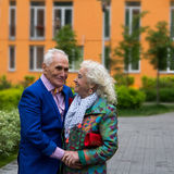 Well-dressed elderly couple talking outdoors. True love. Well-dressed elderly couple talking outdoors Stock Images