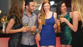 Well dressed friends having party together. In a classy bar stock footage
