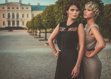 Well-dressed ladies in a beautiful park stock photos