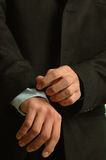 Well dressed man. Male hands fixing his sleave Royalty Free Stock Images