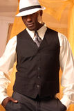 Well dressed man. Brooding african american male with white fedora an vest Stock Photos