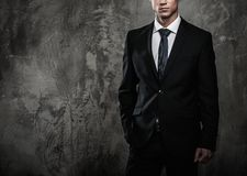 Well-dressed man in black suit Royalty Free Stock Images