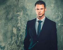 Well-dressed man in black suit Royalty Free Stock Photos