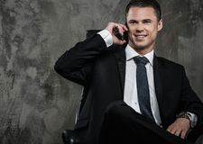Well-dressed man in black suit Stock Photo