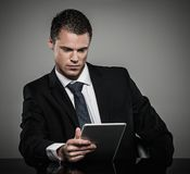 Well-dressed man in black suit Royalty Free Stock Image