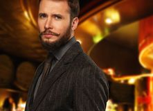 Well-dressed man. Handsome well-dressed man with beard in jacket and tie Stock Photo