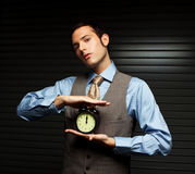 Well Dressed Man holding a clock. Royalty Free Stock Photo