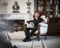 Well-dressed man in luxury house interior Stock Image