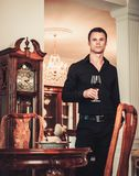 Well-dressed man in luxury house interior Royalty Free Stock Images
