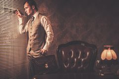 Well-dressed man in retro interior Royalty Free Stock Photos