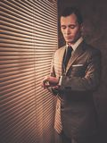 Well-dressed man in retro interior Stock Photo