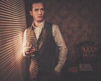 Well-dressed man in retro interior stock photos