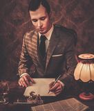Well-dressed man in retro interior Royalty Free Stock Image
