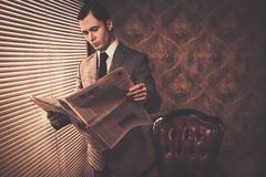 Well-dressed man in retro interior Royalty Free Stock Photo