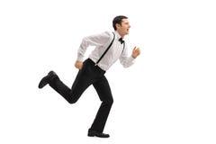 Well-dressed man running Stock Photos