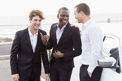Well dressed people posing next to a limousine Royalty Free Stock Photo