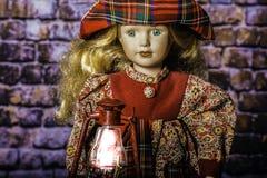 Old Fashion Lantern and Female Doll Royalty Free Stock Photos