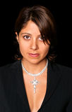 Well Dressed, Pretty Spanish Woman With Bare Chest And Diamond Necklace Royalty Free Stock Photos
