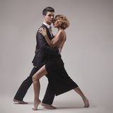 Well-dressed retro couple dancing tango Stock Image
