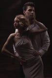 Well-dressed retro couple on dark background Royalty Free Stock Image