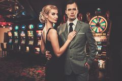 Well-dressed retro style couple in casino Royalty Free Stock Photo